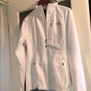 White shell north face jacket